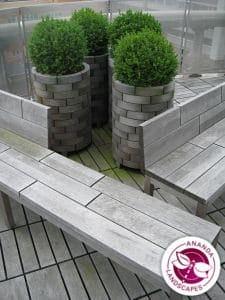 Teak furniture used in landscaping Calgary