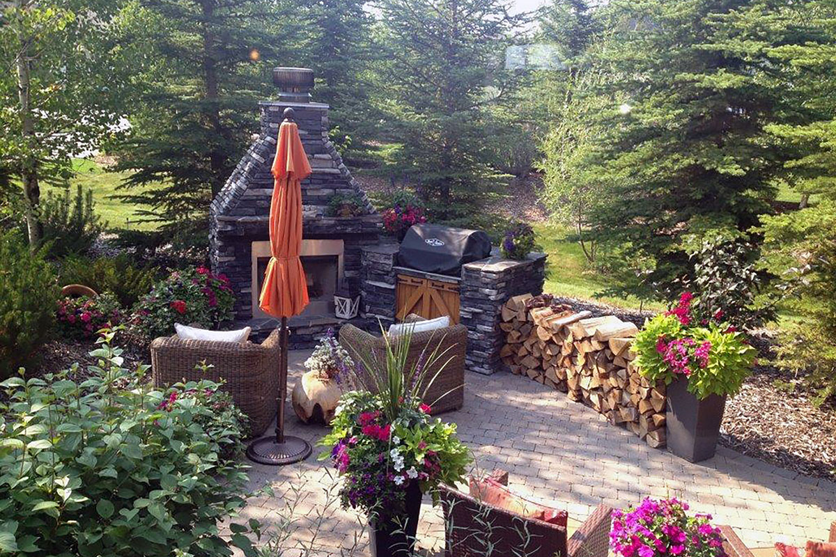 Landscaping Calgary Outdoor Fireplace built by Ananda Landscapes