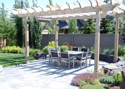 courtyard wooden pergola stone retaining wall