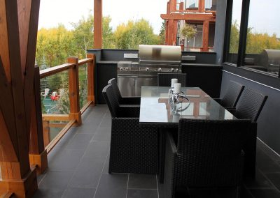 deck-overlooking-backyard-outdoor-kitchen