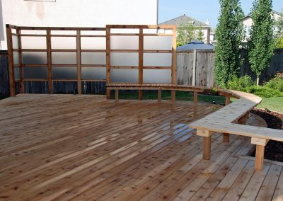 custom made wood deck with bench privacy screen