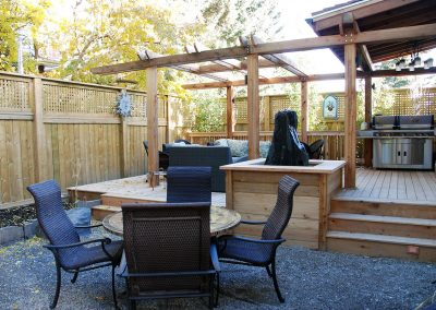 custom made wood wooden deck with bench court yard privacy screen