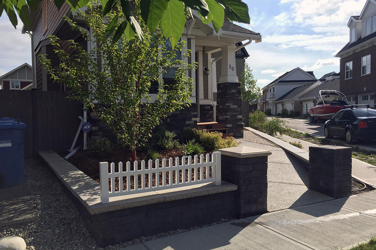 Landscaping Calgary Trees and greenery white fence front yard by Ananda Landscapes