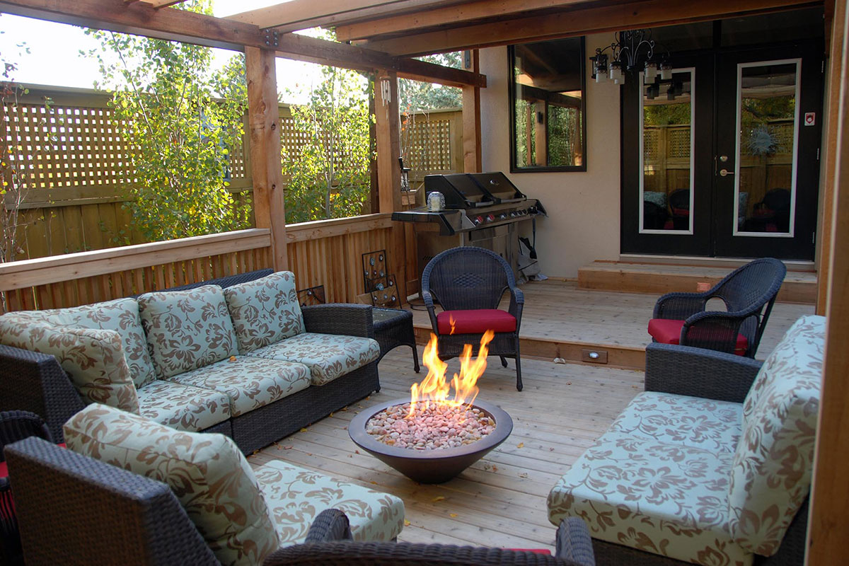 Ananda Landscapes Calgary Outdoor Fireplace in a landscaped backyard