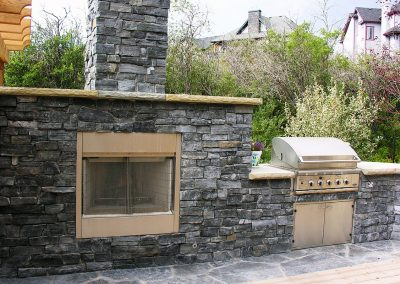 outdoor kitchen barbeque entertaining area fire place