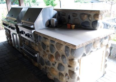 outdoor kitchen barbeque entertaining area stone