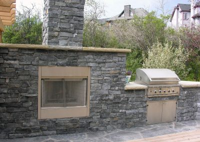 outdoor kitchen barbeque entertaining area fireplace