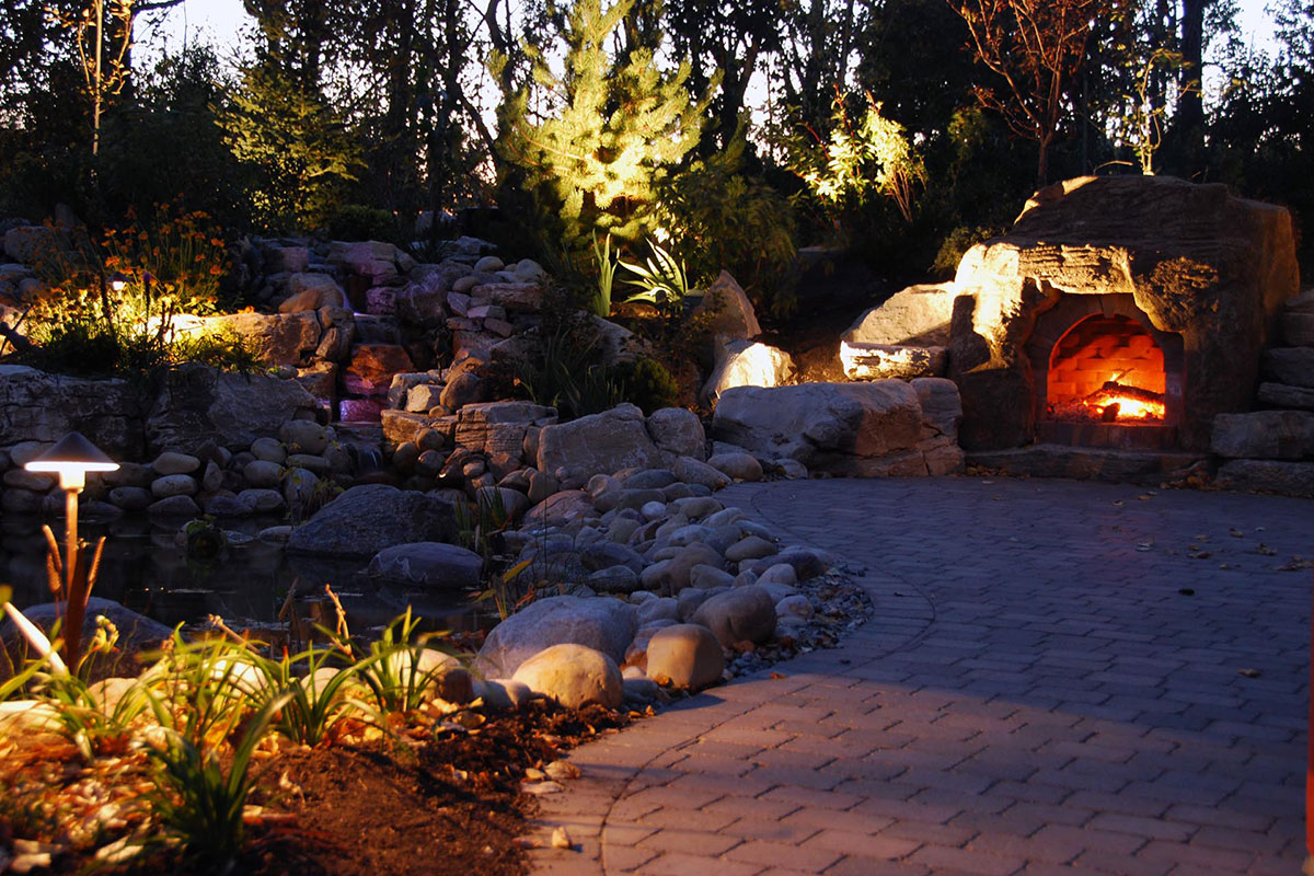 Ananda Landscapes Calgary Outdoor Fireplace brick path