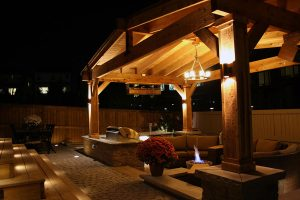 Landscaping Calgary outdoor fireplace fire places fire pit firepit Outdoor lighting lighting night lighting backyard designs