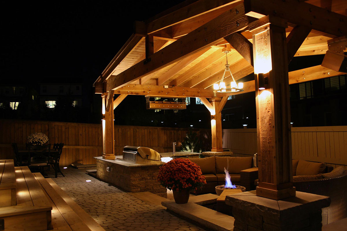 Night time shot of Ananda Landscapes Calgary Outdoor Fireplace