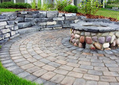 courtyard stone firepit and stone retaining wall