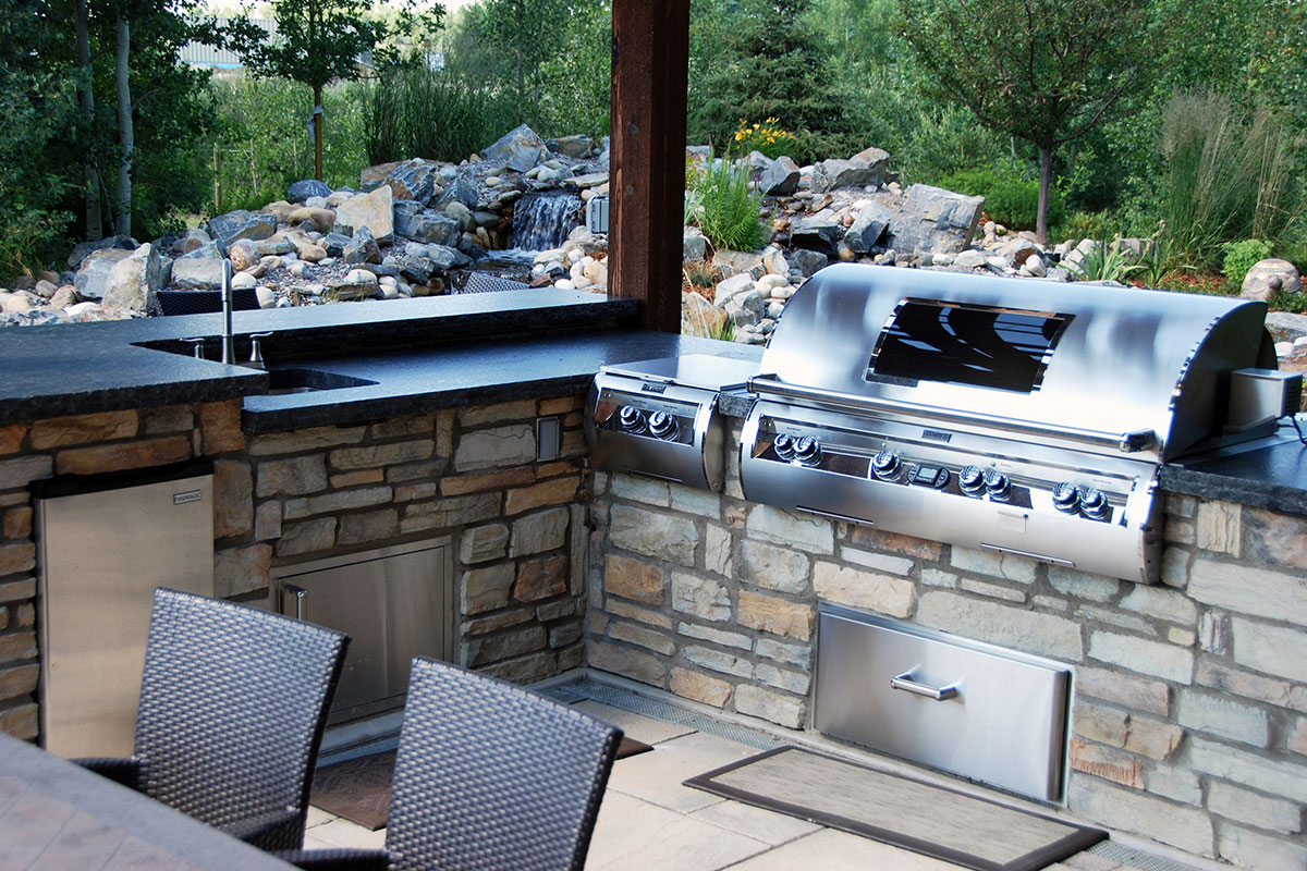 Outdoor kitchen in Calgary backyard courtesy of Ananda Landscapes